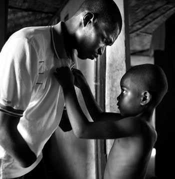 1st prize Contemporary Issues Singles - Yannis Kontos, Greece, Polaris Images - Boy helps his father to dress, Sierra Leone